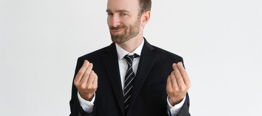 Sneaky business man showing money gesture, asking for money and looking at camera. Payment concept. Isolated front view on white background.