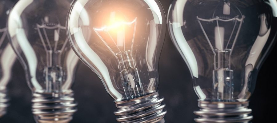Row of light bulb with a one glowing. Idea and innovation concep